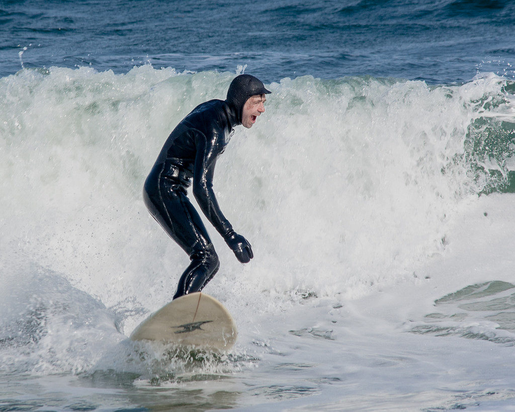 Booties, gloves, hood and full-length wetsuit is a necessity in winter. A  smile, however, is optional.
