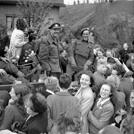 Canadian infantry men surrounded by Dutch civilians partying like it's 1945.
