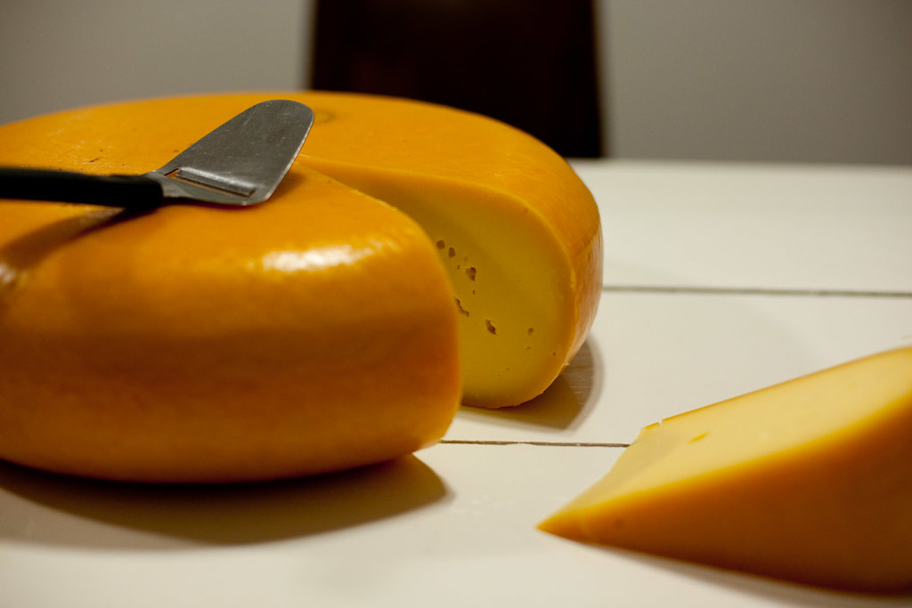A-big-wheel-of-Dutch-cheese-with-a-cheese-slice-on-top