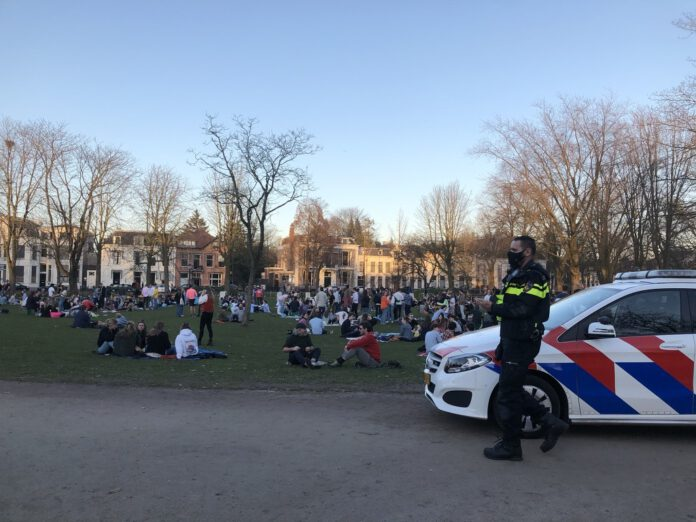 Photo-of-crowded-park-and-Dutch-police-officer-Netherlands