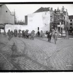 738px-111-SC-201720_-_German_prisoners_of_war_are_marched_into_Liberated_Venlo,_Holland,_by_guards_from_the_task_force_of_the_35th_Infantry_Division