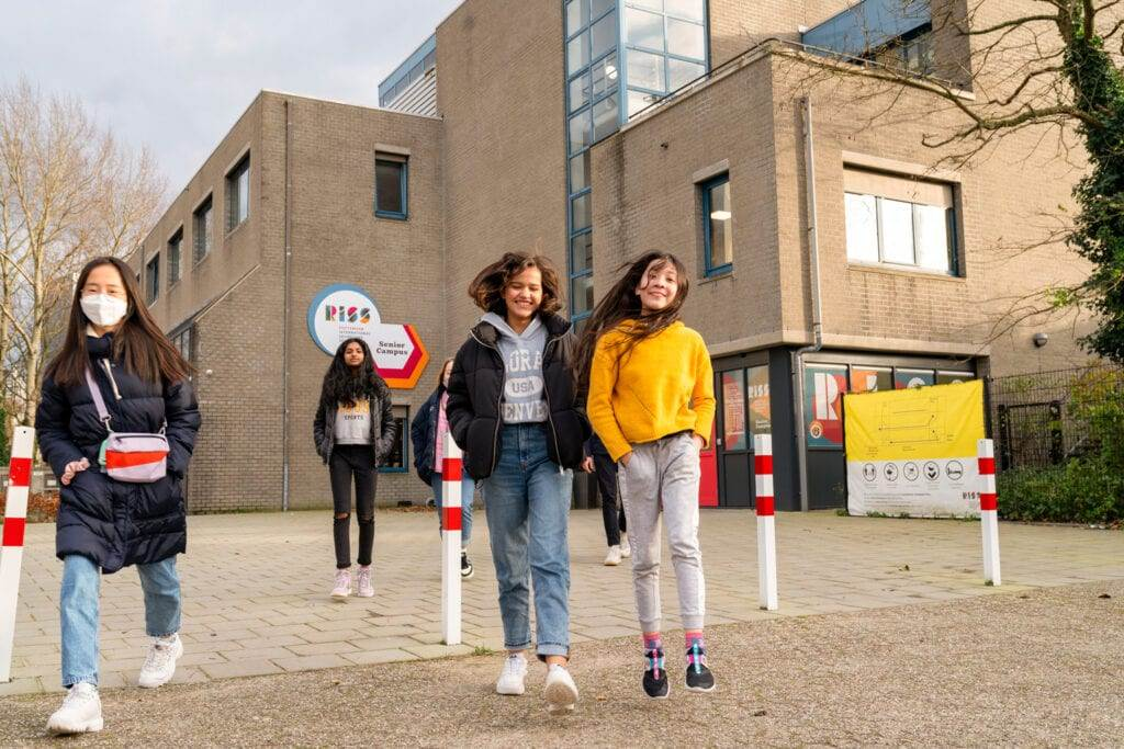 Photo-of-students-of-Rotterdam-International-Secondary-school-walking-outside-school-building