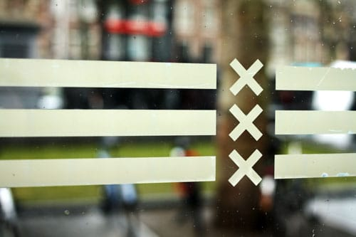 Flag of Amsterdam on bus stop.