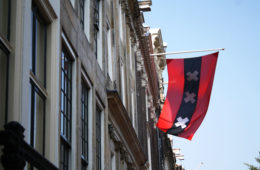 Amsterdam flag on a canal house.