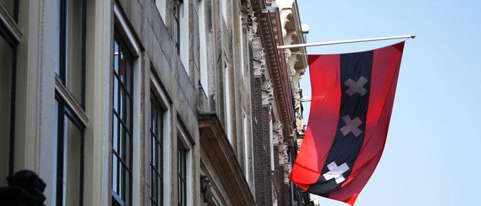 Amsterdam flag on a canal house.