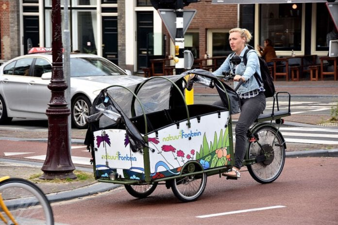 photo-of-woman-on-bakfiets-the-Netherlands