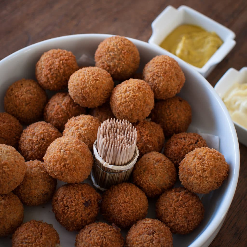 Dutch-delicasy-bitterballen-on-a-table-with-mustard-mayo