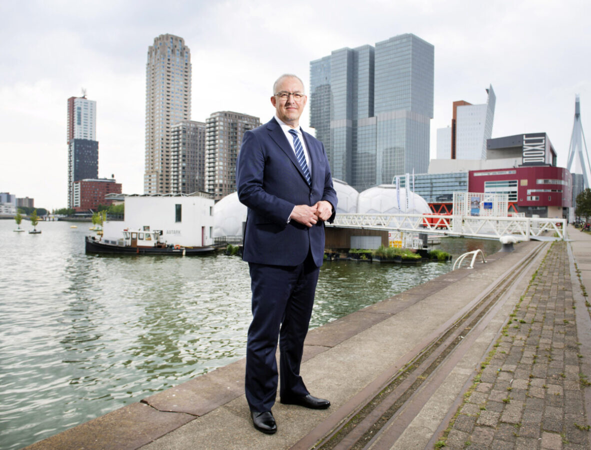 Mayor-Ahmed-Aboutaleb-stands-against-Rotterdam-background