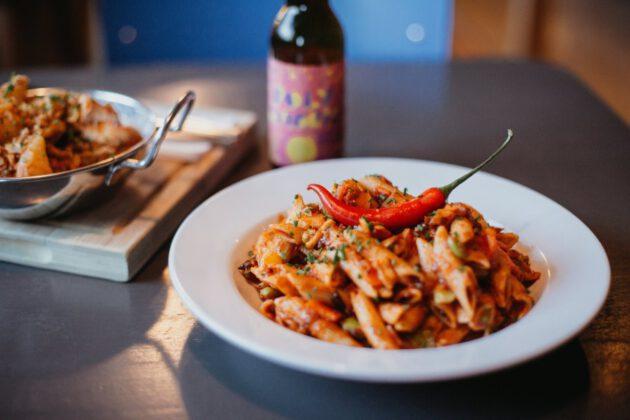 ClinkNOORD Hostel pasta dinner