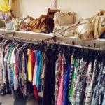 Clothing_racks_in_second_hand_shop,_Prague