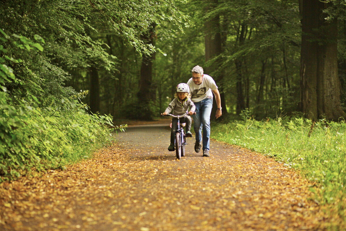 Photo-of-child-on-bike-with-parent