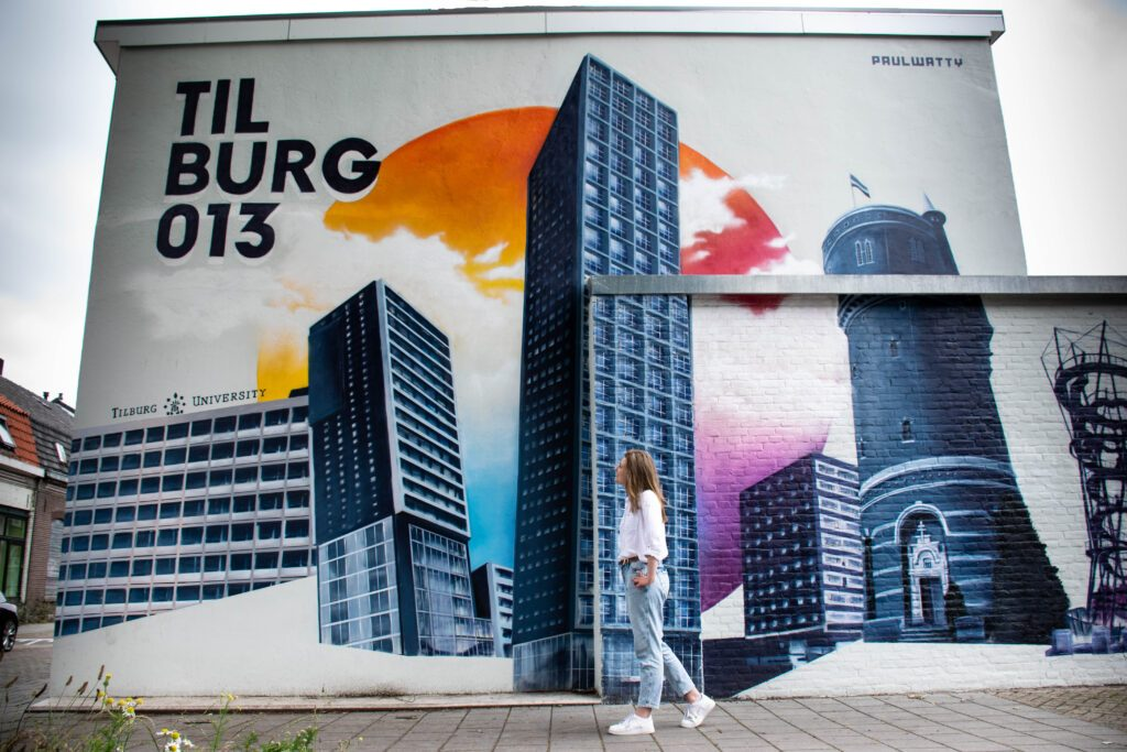 photo-of-a-girl-in-front-of-a-mural-in-tilburg