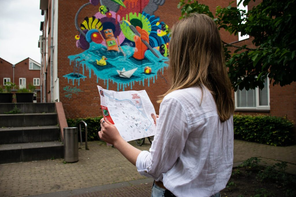 photo-of-a-girl-looking-at-a-map-of-street-art-in-tilburg