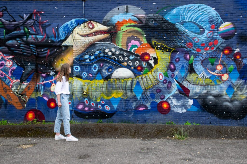 photo-of-a-girl-looking-at-street-art-in-tilburg