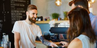 Photo-of-customers-paying-using-bank-card-in-coffee-shop-Netherlands