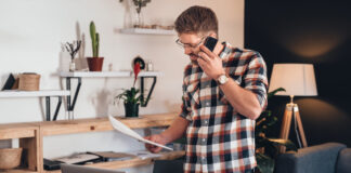 Photo-of-self-employed-man-on-the-phone-paying-taxes