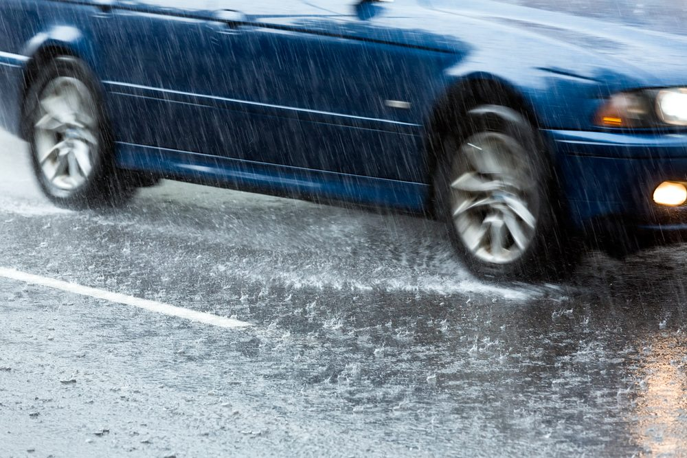 Car-drives-dwn-flooded-road-in-South-Limburg-after-record-breaking-thunderstorm