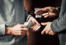 Photo-of-two-men-exchanging-money-for-drugs