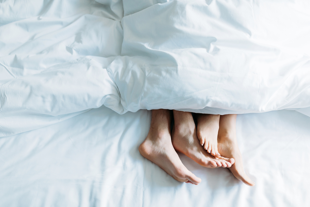 Dutch-couple's-feet-poking-out-of-the-covers-in-bed