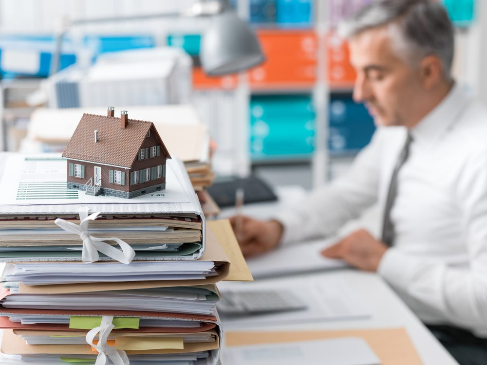 Photo-of-real-estate-agent-doing-research-when-buying-a-house