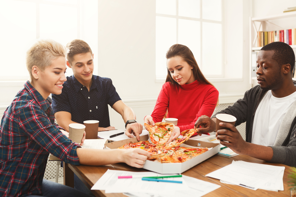 A-international-group-of-friends-eating-pizzsa-in-the-Netherlands