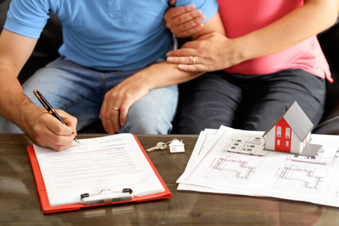 couple-signing-housing-contract