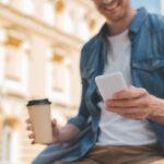 Raisin savings platform man on phone