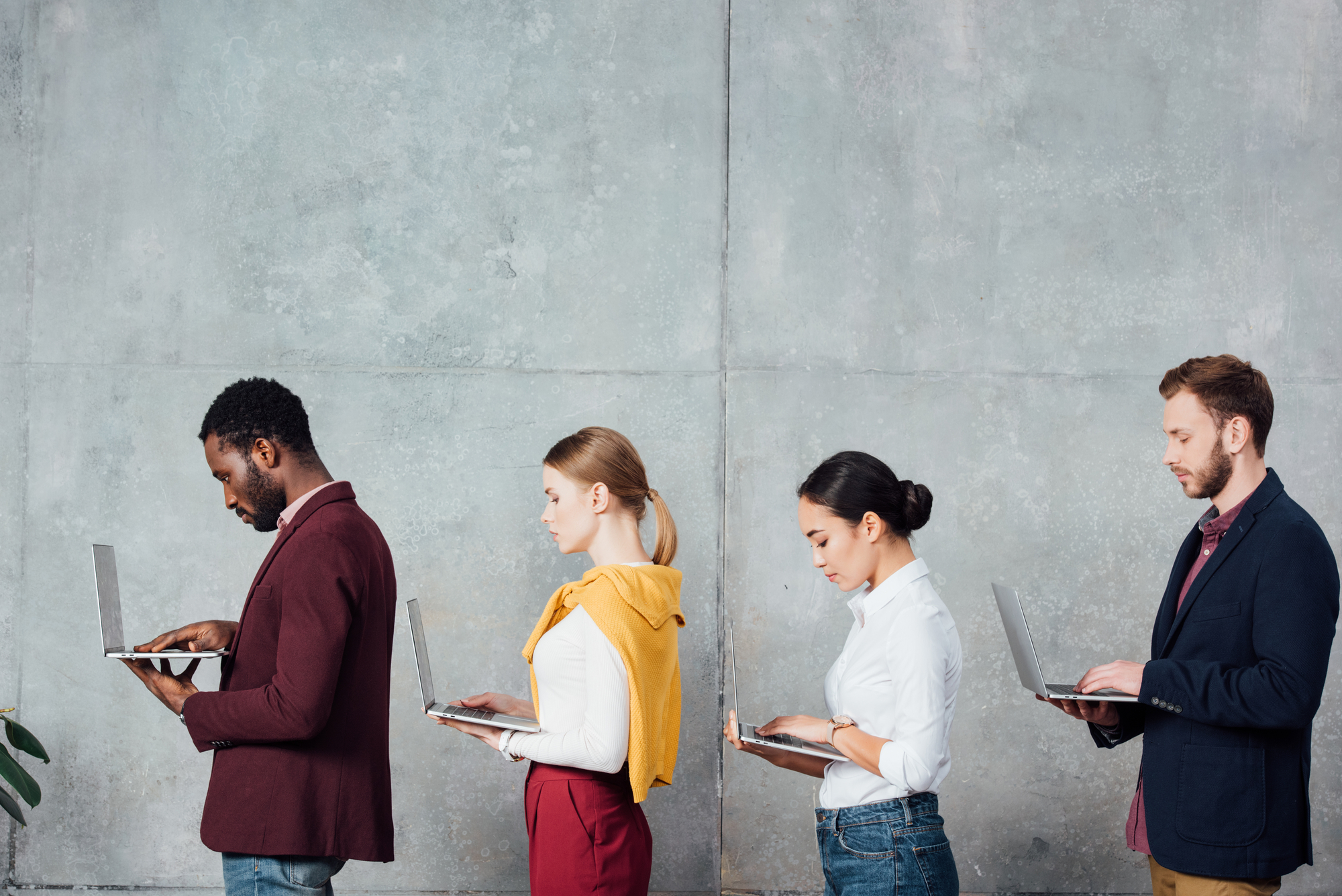 photo-people-standing-in-a-row-working-with-their-laptops