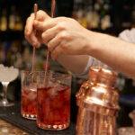 Bartender is stirring cocktails