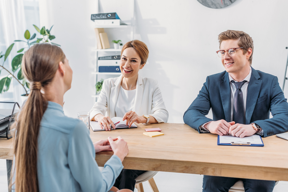 Photo-of-woman-sitting-in-chair-in-front-of-table-with-interviewers-at-job-interview-in-the-Netherlands