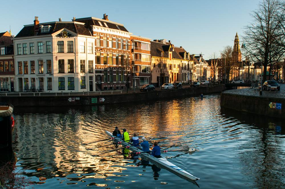 photo-of-people-rowing-on-the-canals-of-groningen-city-with-cleanest-air-in-the-netherlands