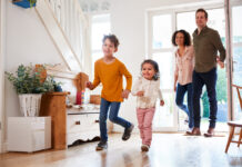 Photo-of-family-walking-into-house-in-Netherlandsds