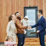 Caucasian family buy apartment with realtor