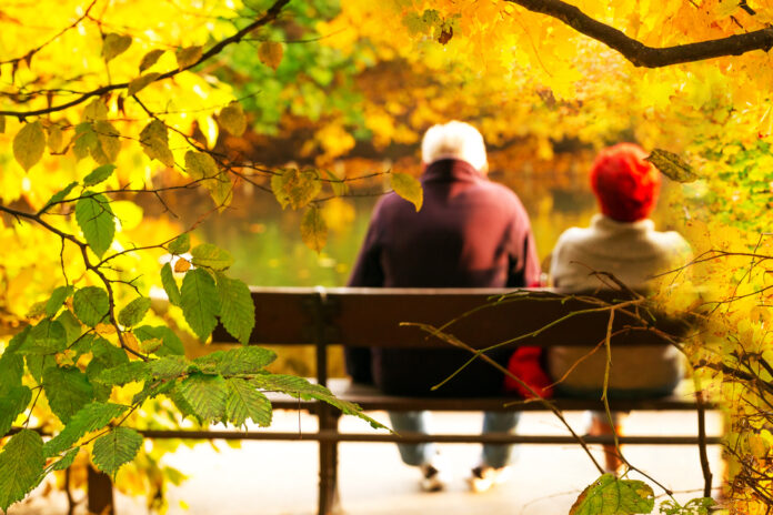 Photo-of-elderly-couple-sitting-on-bench