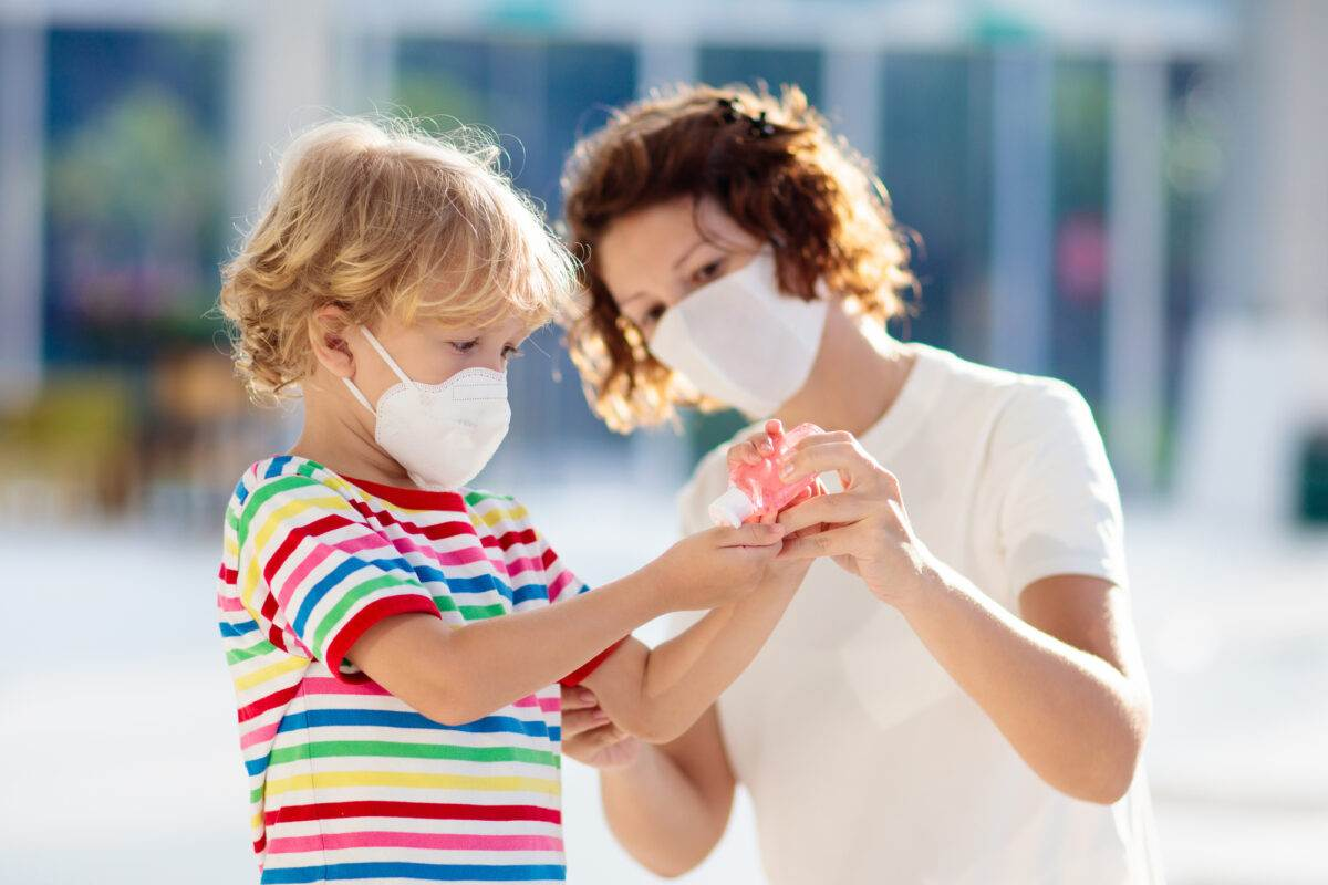 photo-of-a-mom-with-a-child-wearing-face-masks