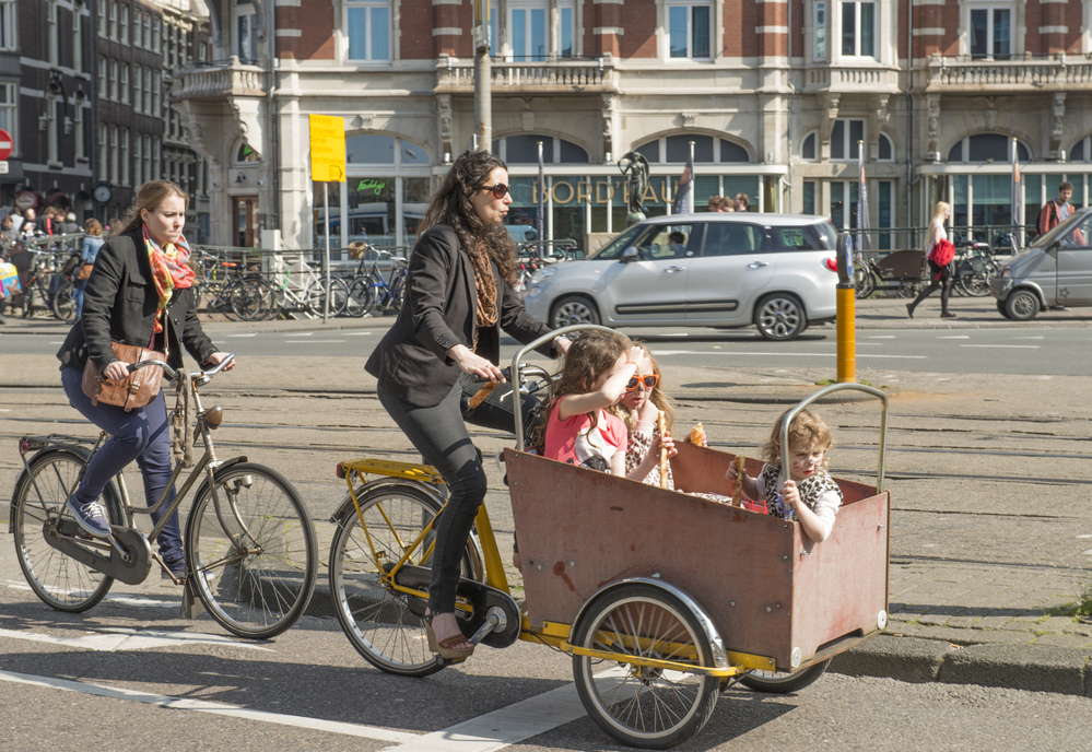 photo-of-two-women-on-bicycles-in-the-netherlands