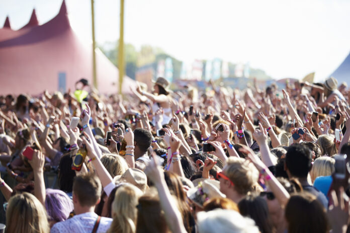photo-crowd-with-their-hands-up-at-music-festival