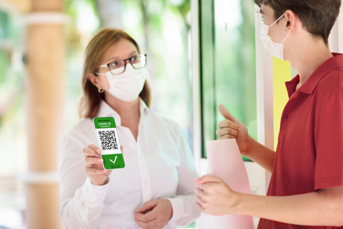 Photo-of-woman-shwoing-QR-code-before-dining-indoors