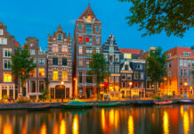 photo-of-amsterdam-canal-houses-at-night
