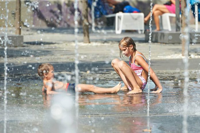 Photo-of-children-playing-in-water-fountain-during-hot-warm-weather