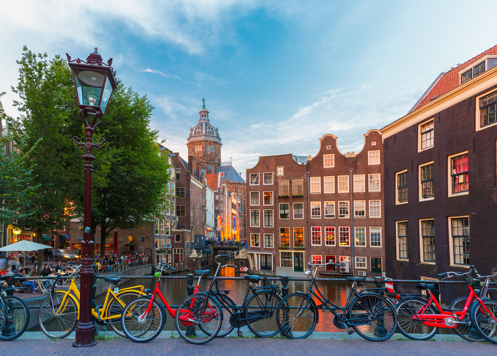 photo-of-bikes-parked-in-front-of-amsterdam-canal