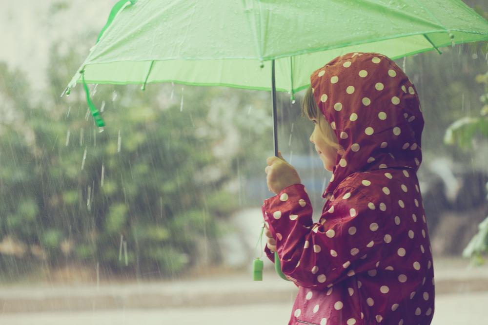 A-child-holding-an-umbrella-in-the-rain-during-a-normal-Dutch-summer