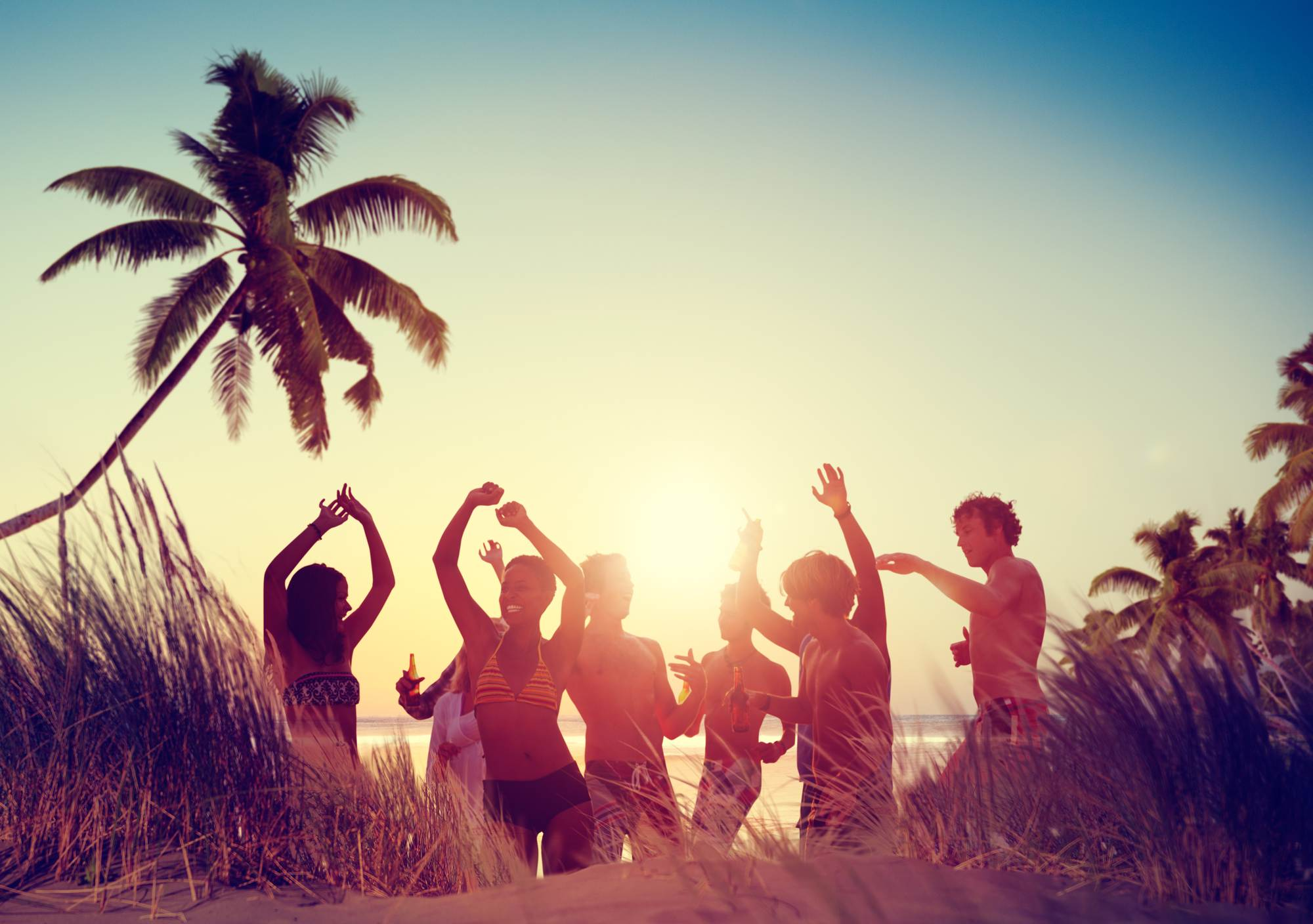 Dutch-people-dancing-on-a-beach-on-holiday