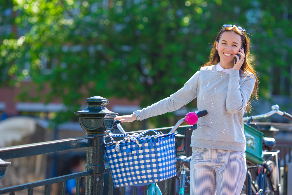Dutch-woman-with-a-bike-being-a-happy-on-the-phone