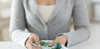 Photo-of-woman-counting-euro-bills-from-her-salary