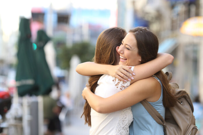 photo-two-happy-friends-hugging