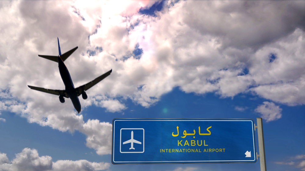 Airplane -silhouette-landing-in-Kabul, Afghanistan. City arrival with international airport direction signboard and blue sky in background. Travel, trip and transport concept 3d illustration.