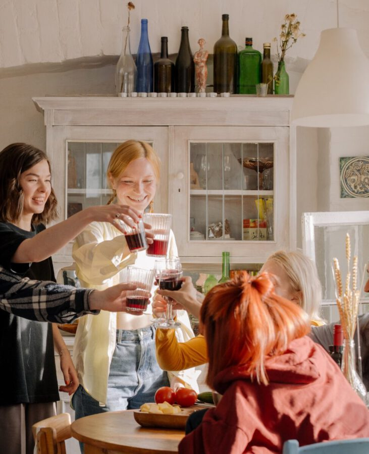 Dutch-female-students-cheersing-with-wine-in-a-student-society-house