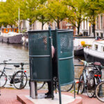 Man urinating in Amsterdam in a public urinal