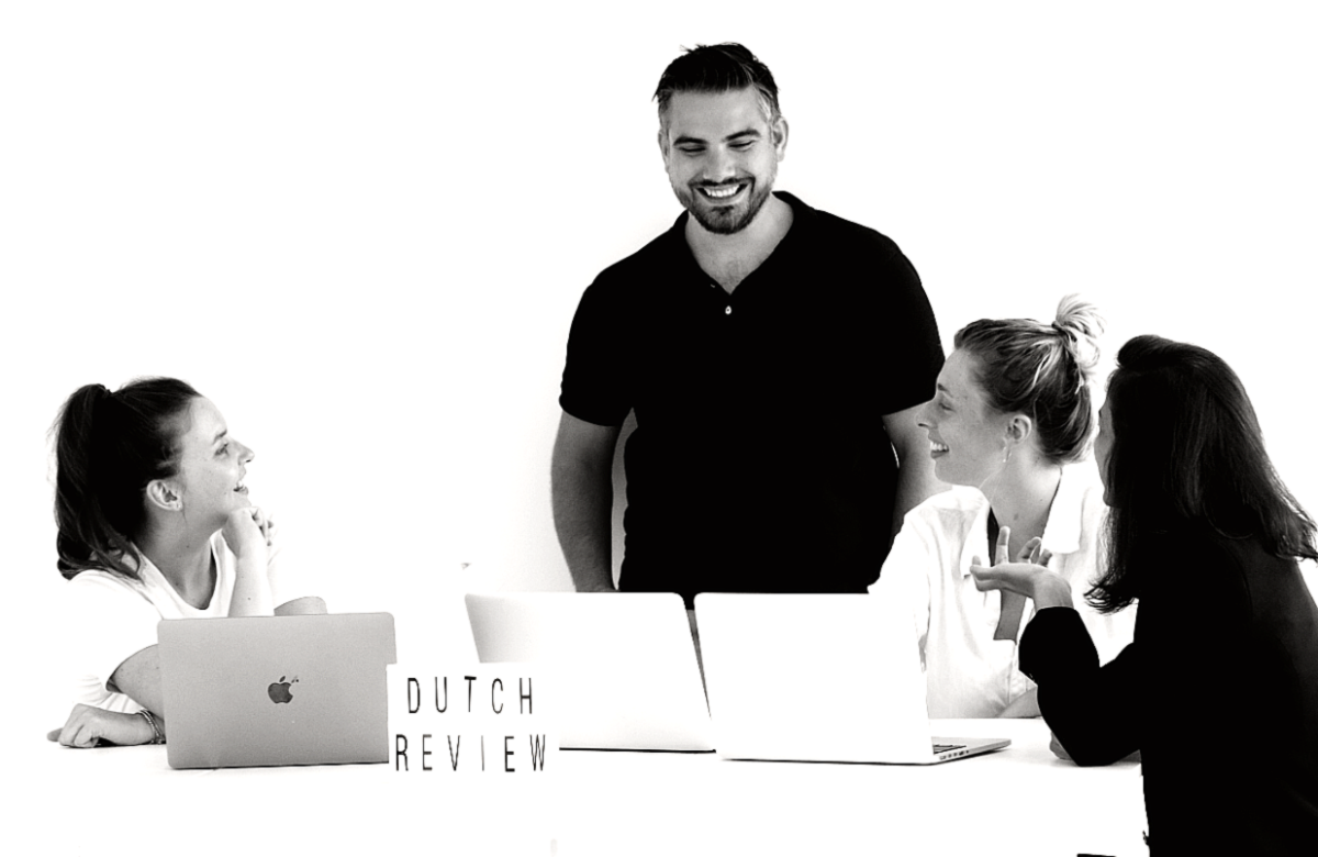 Four DutchReview team members working